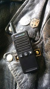 Tiny radio attached to leather jacket